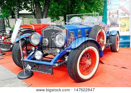 Kharkiv Ukraine - May 22 2016: Retro car blue Ford manufactured between 1935 and 1939 is presented at the festival of vintage cars Kharkiv Retro Rally - 2016 in Kharkiv Ukraine on May 22 2016