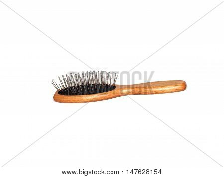 Wooden hair brush isolated on a white background.