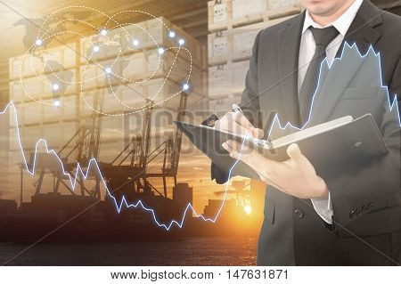 Double Exposure Of Professional Businessman Analyzing Market Trend With Transportation Port , Blurre