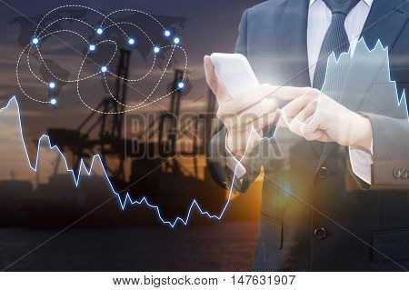 Double exposure of professional businessman connect internet smart phone and distribution transport port with international world financial graph Business finance trading and banking concept world map element of this image furnished by NASA