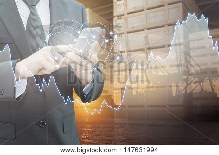 Double exposure of businessman connect network internet with smart phone logistic port and blurred cargo warehouse background international transportation trading business concept element of this image furnished by NASA