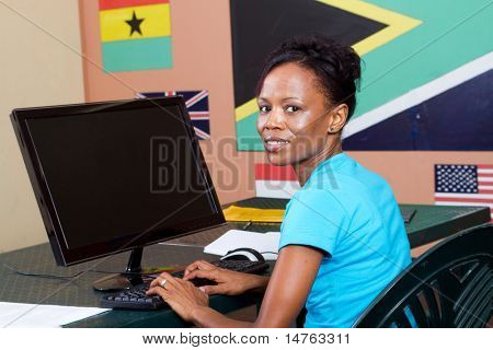 African American adult student learning computer
