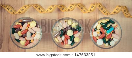 Vintage Photo, Colorful Medical Pills And Capsules With Centimeter, Health Care And Slimming Concept
