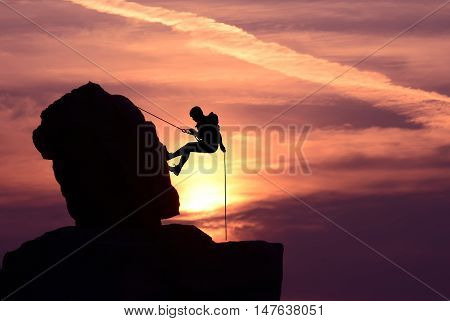 Silhouette of a climber over beautiful sunset
