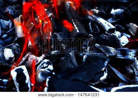 Red hell-fire burning on black coals incineration combustion
