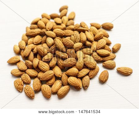 Pile Of Tasty Almonds Nuts On White Background. Inexpensive Real Food Snack For Sport And School