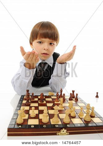 schoolboy playing chess. Isolated on white background poster