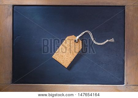 Single cork hang tag on wooden framed chalkboard space for text