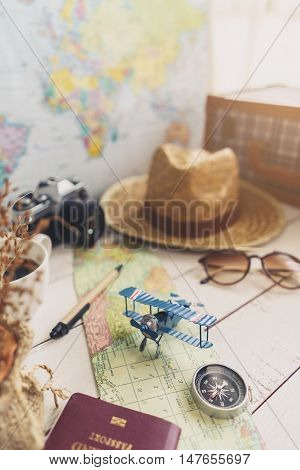 Map and accessories of traveler on wooden background Travel planning