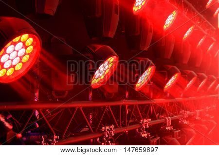 Stage lighting equipment. Modern Concert spotlight. The direct rays of light in the haze.