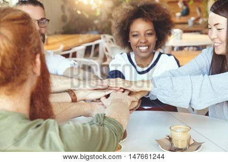 Friendship And Communication Concept. Group Of Young Trendy Students At Coffee Shop Sitting At Table