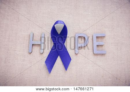 Blue Ribbon With Hope Word,  Child Abuse, Colon Cancer And Colorectal Cancer Awareness