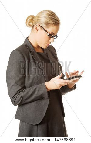 Businesswoman sending a message