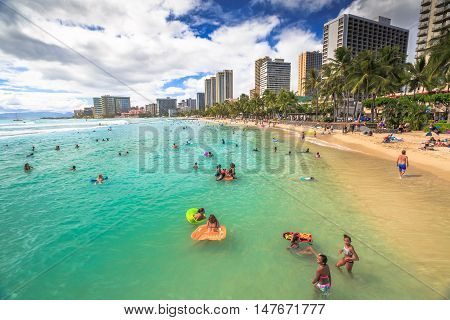 Waikiki Oahu HI - August 27 2016: Prince Kuhio Beach also called The Ponds because bounded by concrete walls that have created a calm water swimming pool. Kuhio Beach is great for boogie boarding.