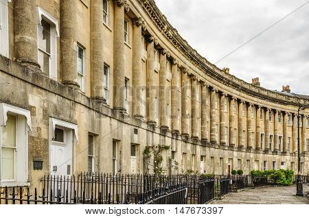 The Royal Crescent is a row of 30 historic terraced homes in the city of Bath, England. Georgian architecture.