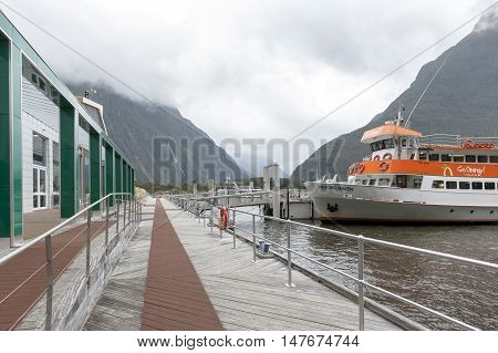 Milford Sound, New Zealand - February 2016: Tourist Boat Docking At Milford Sound Passenger Terminal