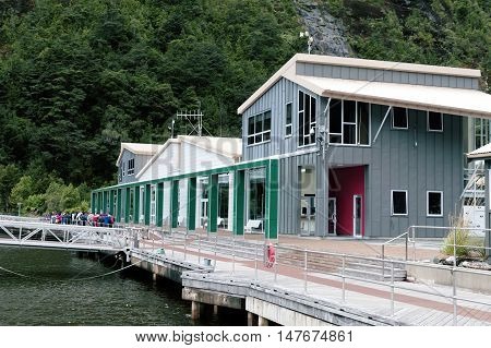 Milford Sound, New Zealand - February 2016: Passenger terminal and boat pier at Milford Sound