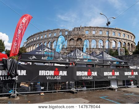 PULA, CROATIA - SEPTEMBER 17, 2016 - Ironman village open stores in front of amphitheater in Pula Croatia on September 17 2016.