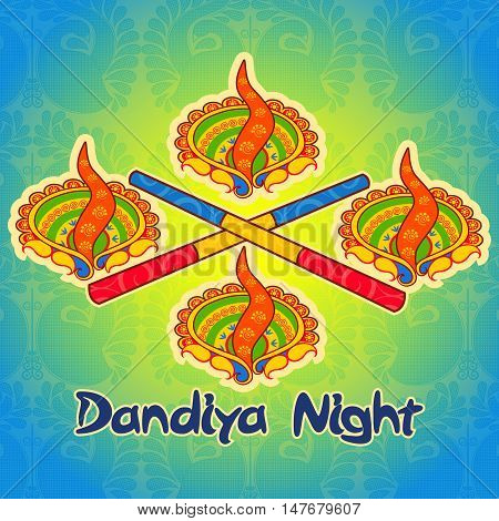 Vector design of diya lamp and stick for Dandiya night