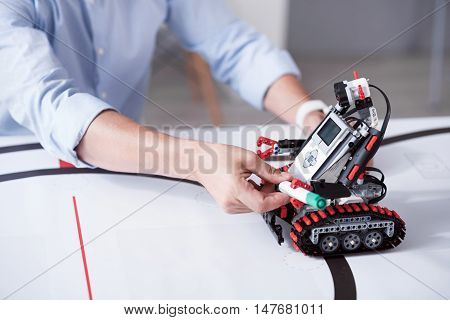 Do the job. Robot conducts human function capably oparating with his plastic hands