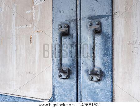 Blue steel door handles of the old wooden door, With place your text (door, handle, vintage)