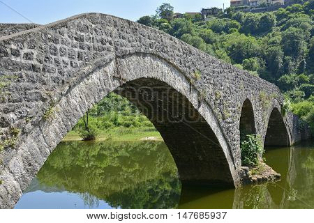 The old bridge in Rijeka Crnojevica Montenegro also known as Danilo's Bridge or Danilov Most was built across the Crnojevica River in 1853 to replace an earlier wooden bridge. The 43 metre limestrone bridge has a double arch. Originally built as a road br