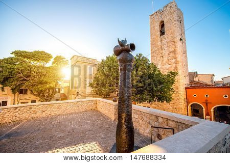 Antibes, France - June 14, 2016: Central square near art museum of Picasso with modern sculpture by Joan Miro sculptor in Antibes village in France.