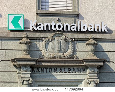 Rapperswil, Switzerland - September 12, 2016: sign and relief on the wall of an St. Gallen Cantonal bank office. Cantonal banks are Swiss state-owned commercial banks.