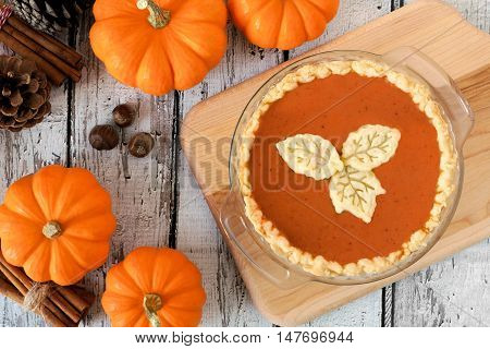 Thanksgiving Pumpkin Pie With Leaf Pastry Toppings, Overhead Scene With Rustic White Wood Background