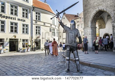 Tallinn Estonia - July 29th 2016: medieval warrier in Old City Tallinn. Writing on the wall reads: 'The House of Hopner'
