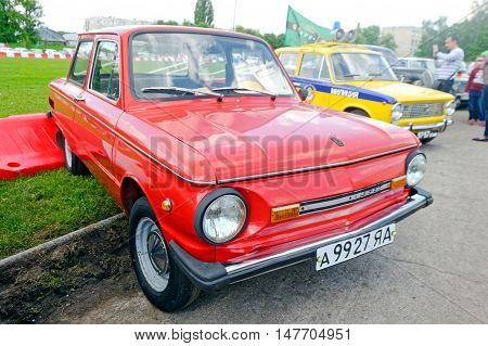 Kharkiv Ukraine - May 22 2016: Soviet retro car red ZAZ-968M is presented at the festival of vintage cars Kharkiv Retro Rally - 2016 in Kharkiv Ukraine on May 22 2016