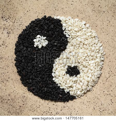 Black and white sesame seeds forming the yin and yang symbol photographed overhead with natural light
