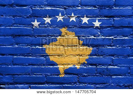 Flag of Kosovo painted on brick wall poster