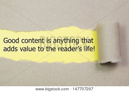 The quote Good content is anything that adds value to the readers life, appearing behind torn brown paper