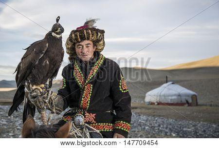 Bayan Ulgii Mongolia September 30th 2015: Portrait of a Mongolian eagle hunter with his eagle