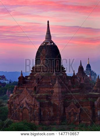 Ancient temple in Bagan Archaeological zone at twilight Myanmar. Bagan's prosperous economy built over 10000 temples between the 11th and 13th centuries.