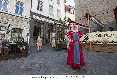 Tallinn Estonia - July 29th 2016: a lady in old traditional clothing posing in old cityTallinn