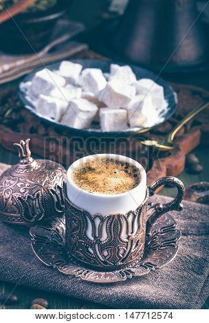 Traditional turkish coffee with turkish delight. Embossed metal cup. Toned