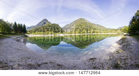 Crystal clear blue water lake and mountains. Panorama of wild landscape natural environment. Julian Alps Triglav National Park in Slovenia.