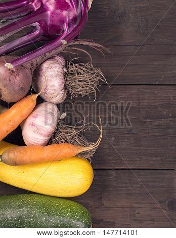 Various vegetables at left side rustic dark table