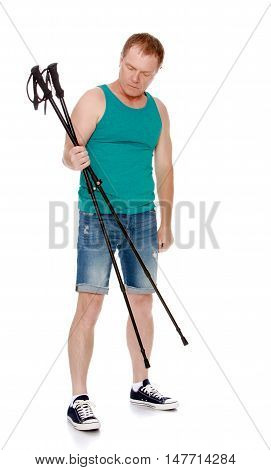 The concept of a healthy lifestyle and exercise.A 50 year old man involved in Nordic walking.Holds the sticks for Nordic walking.Isolated on white background