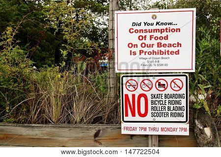 A sign in Ocean Beach Fire Island NY that sais no eating skating biking roller blading and scooter riding