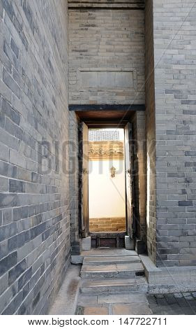 A traditional chinese doorway with the Kong Family mansion property in the city of Qufu located in Shandong Province China.