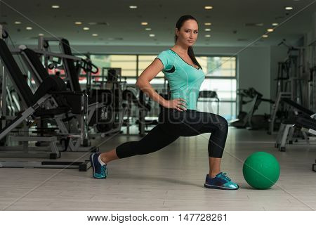 Attractive Woman Doing Stretching With Medicine Ball