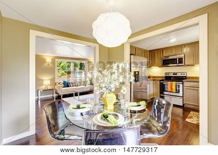 Modern Dining Area With Glass Table Set. Open Floor Plan.
