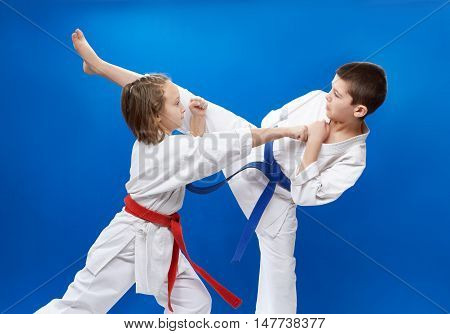 In karategi two athletes are doing blocks and kicks of karate