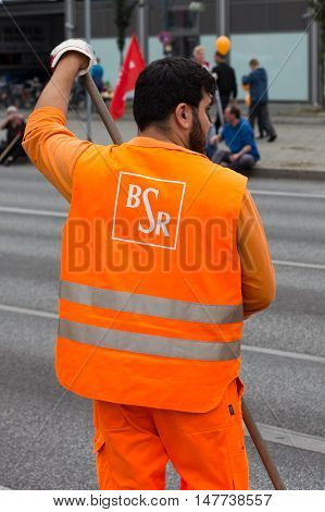 Berlin Germany - September 17 2016: Logo of the Berlin Waste Management and City Cleaning company BSR on worker uniform.