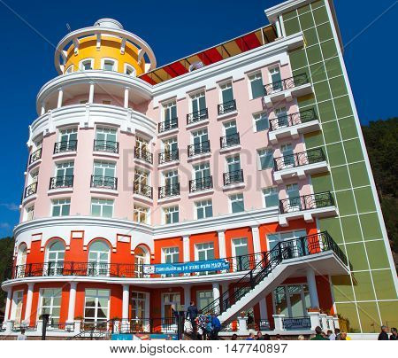 LISTVYANKA RUSSIA - 17 SEPTEMBER 2016: View of the Listvyanka settlement (Irkutsk oblast) Mayak hotel.