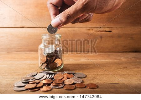 Save money concept Close up of hand stacking silver coins on wooden table, Save money for prepare still life style