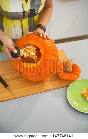 Closeup On Woman Prepare Big Orange Pumpkin Jack-o-lantern